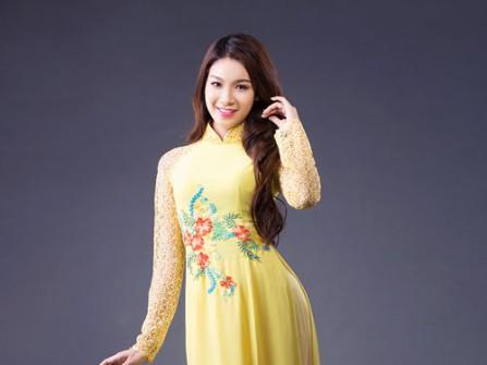 Áo dài cô dâu màu vàng tay ren thêu hoa