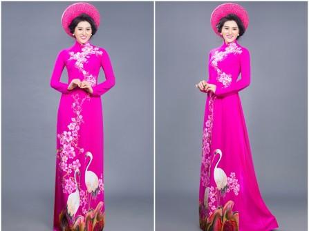 Áo dài cưới màu hồng cánh sen vẽ đôi chim hạc