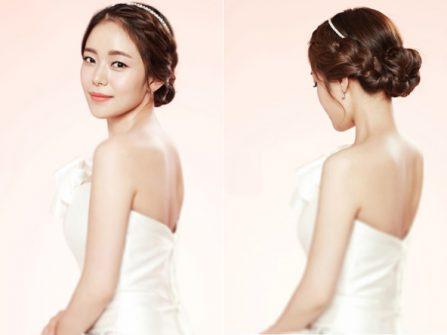 Tóc cô dâu đẹp thắt bím kết hợp búi thấp dịu dàng