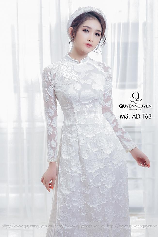 Áo dài cưới trắng đơn giản hoa lá Marry